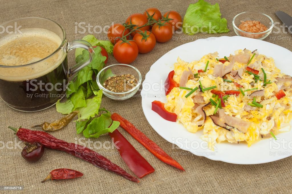 Homemade breakfast with a cup of coffee.Fresh scrambled eggs stock photo