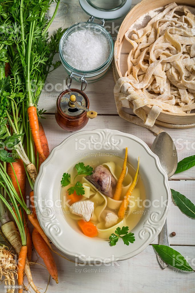 Homemade broth with noodles stock photo