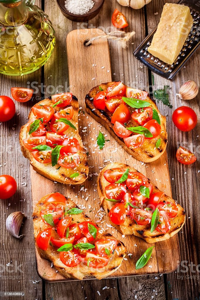 homemade bruschetta with cherry tomatoes and basil stock photo