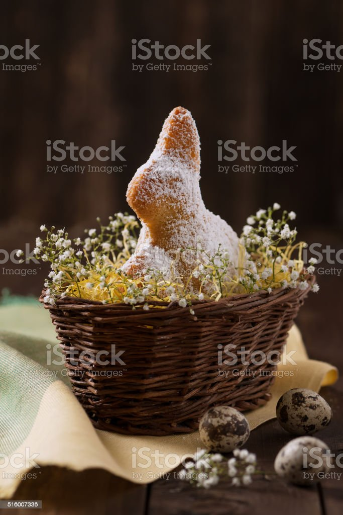 Homemade bunny cake in a nest of Easter basket. stock photo