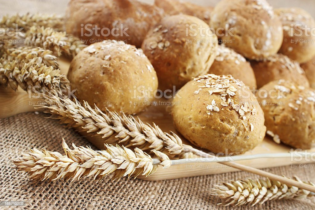 Homemade buns with wheat ears royalty-free stock photo