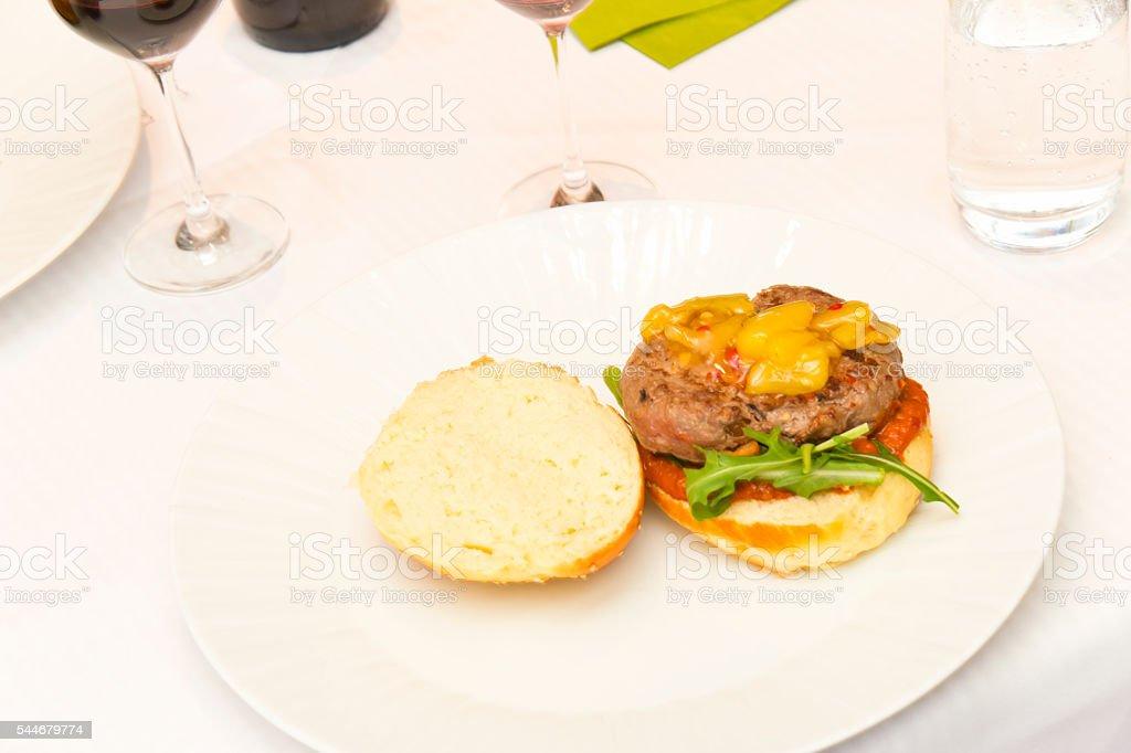 Homemade Burger on Dinner Table stock photo