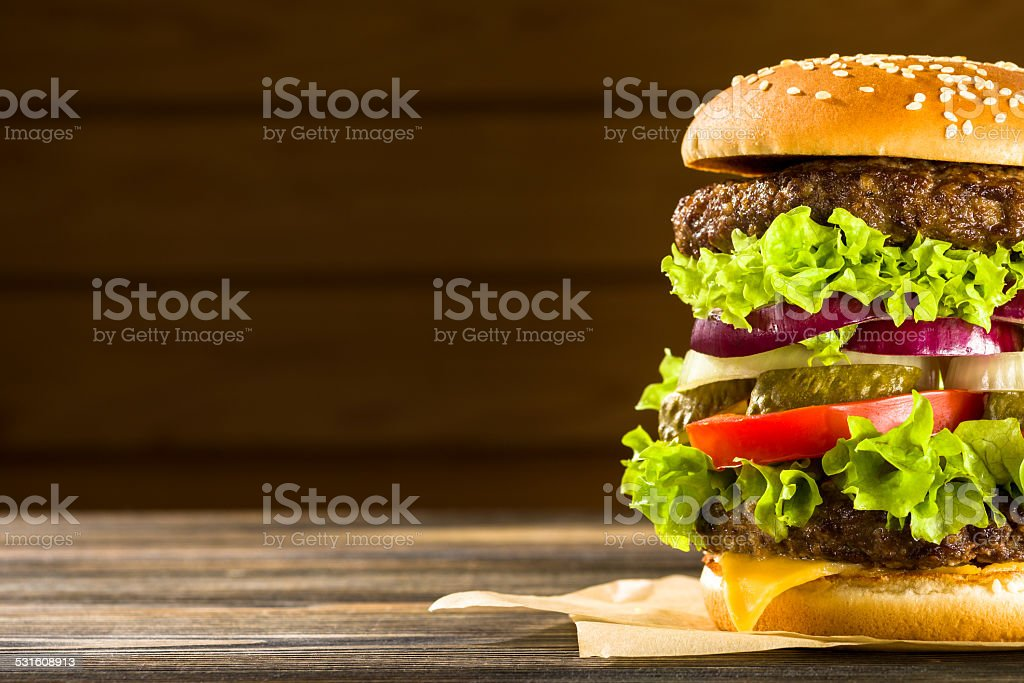 Homemade burger on the wooden table stock photo