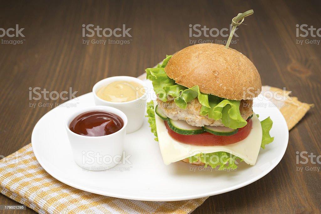 homemade burger with ketchup and mustard royalty-free stock photo