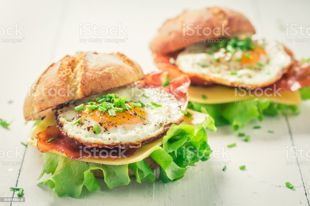 Homemade burger with lettuce, bacon and eggs stock photo