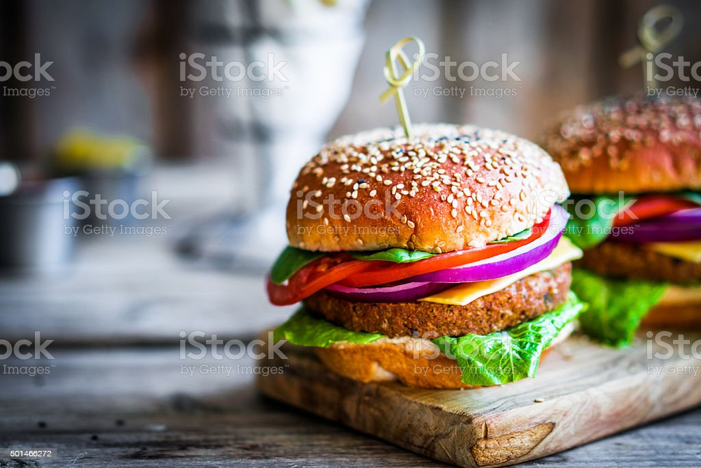 Homemade burgers on rustic wooden background stock photo