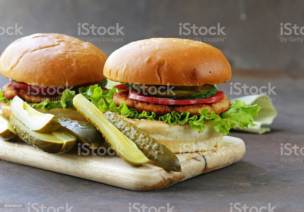 homemade burgers with fresh vegetables and pickles stock photo