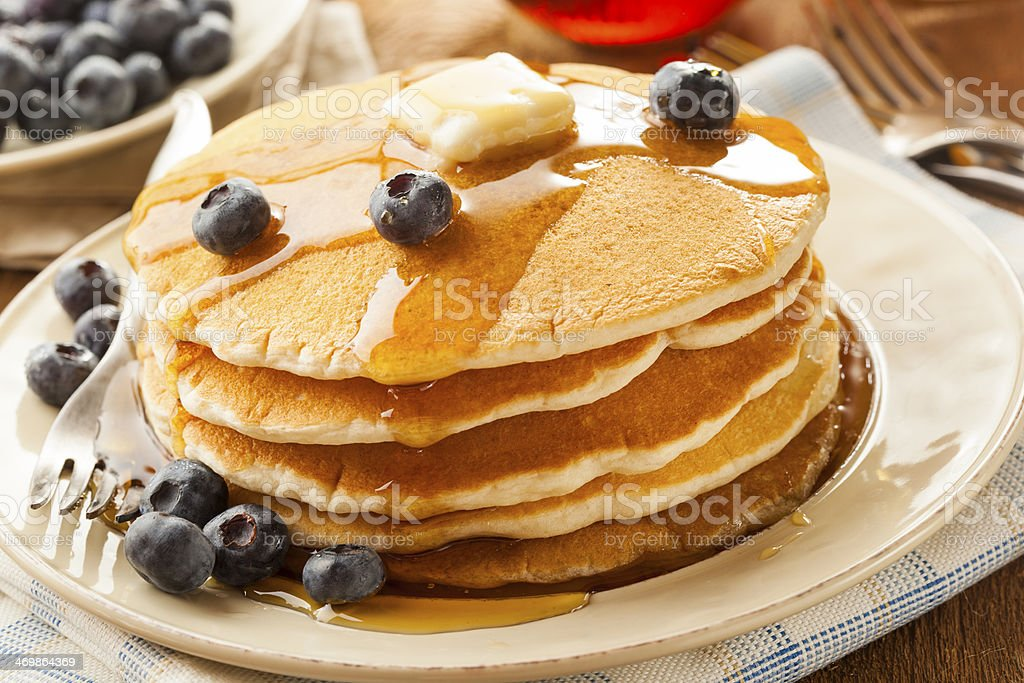 Homemade Buttermilk Pancakes with Blueberries and Syrup stock photo