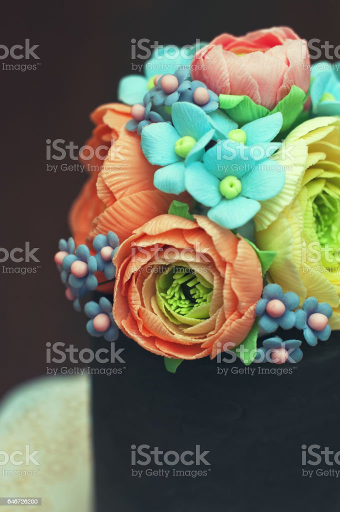 Homemade cake with sugar paste edible floral decorations stock photo