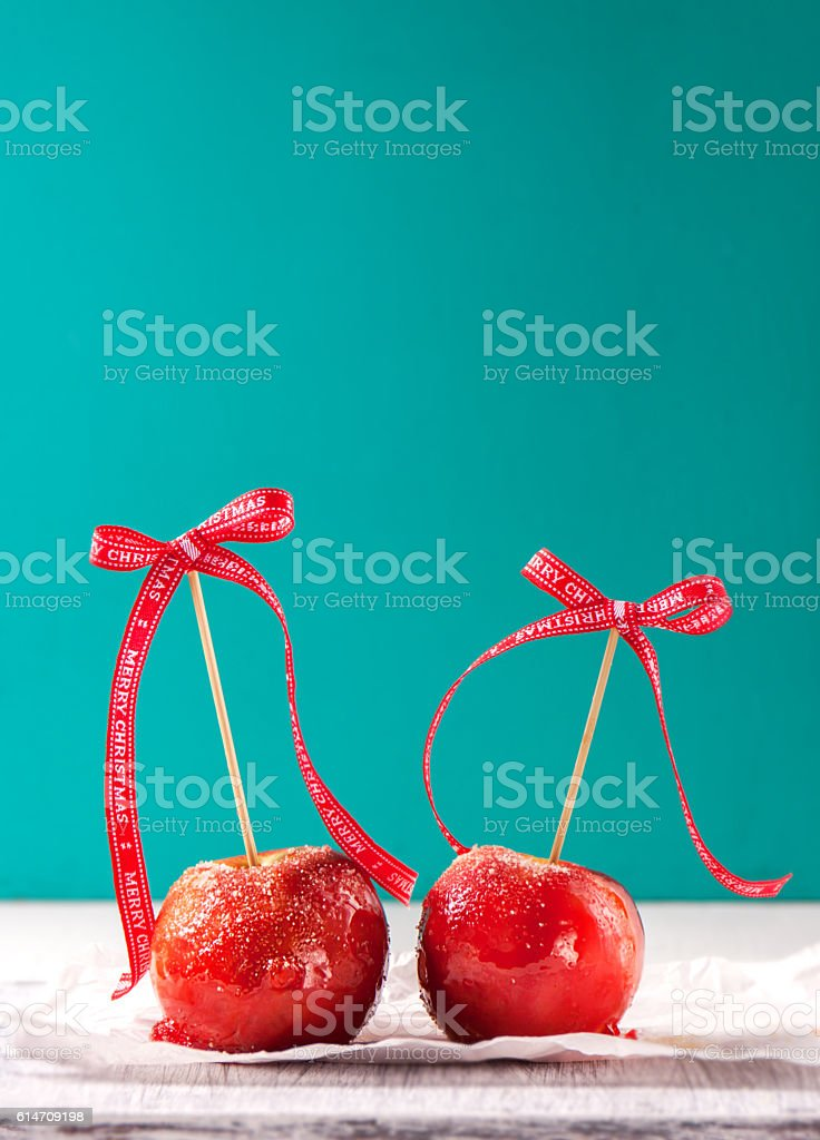 Homemade candied apples with a red bow stock photo