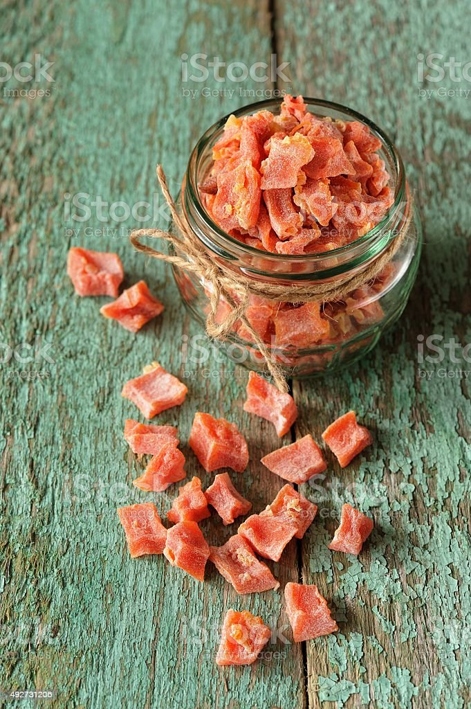 Homemade candied butternut squash pieces in glass jar stock photo