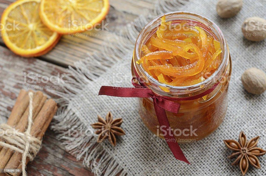 Homemade candied peels orange jam in glass jar royalty-free stock photo