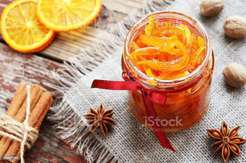 Homemade candied peels orange jam in glass jar stock photo
