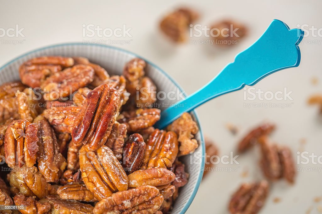 Homemade Caramelized pecans with maple syrup stock photo
