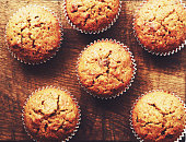 Homemade carrot muffins on brown wooden background
