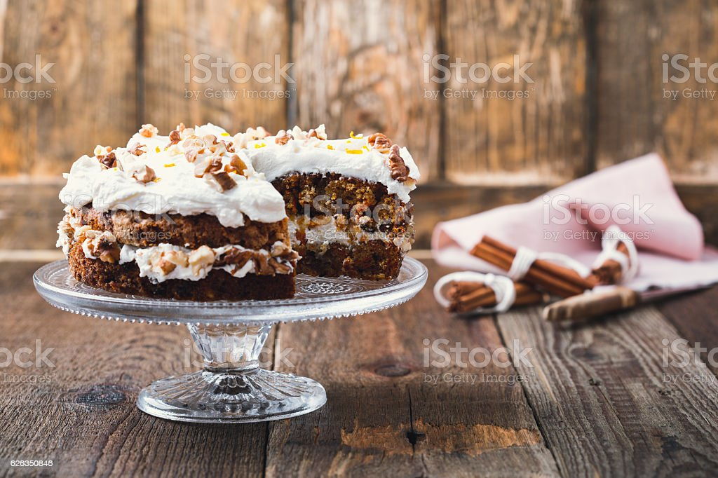 Homemade carrot orange cake with cream cheese frosting stock photo
