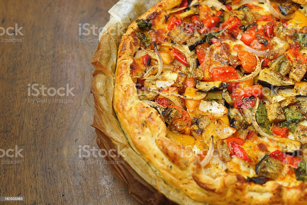 Homemade Cheese and Vegetable Pizza Pie in Greaseproof Paper royalty-free stock photo