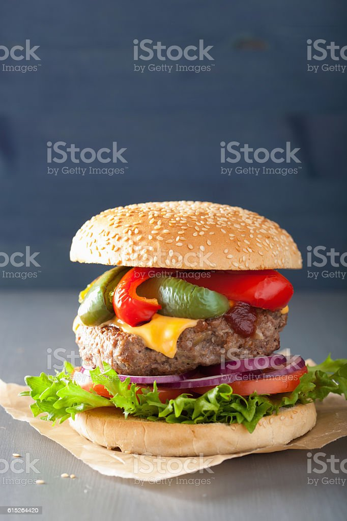 homemade cheese burger with peppers tomato onion stock photo