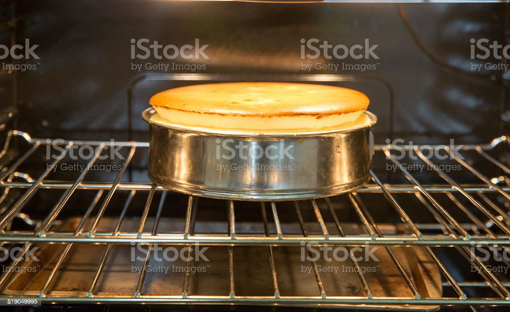 Homemade cheesecake rising in the oven  rr stock photo