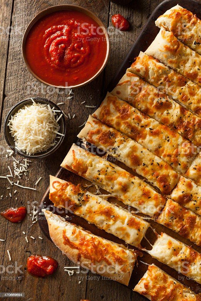 Homemade Cheesy Breadsticks with Marinara stock photo
