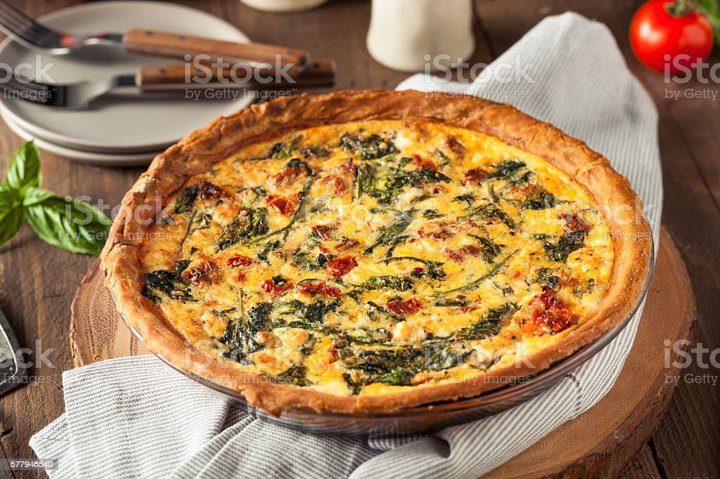 Homemade Cheesy Egg Quiche for Brunch stock photo