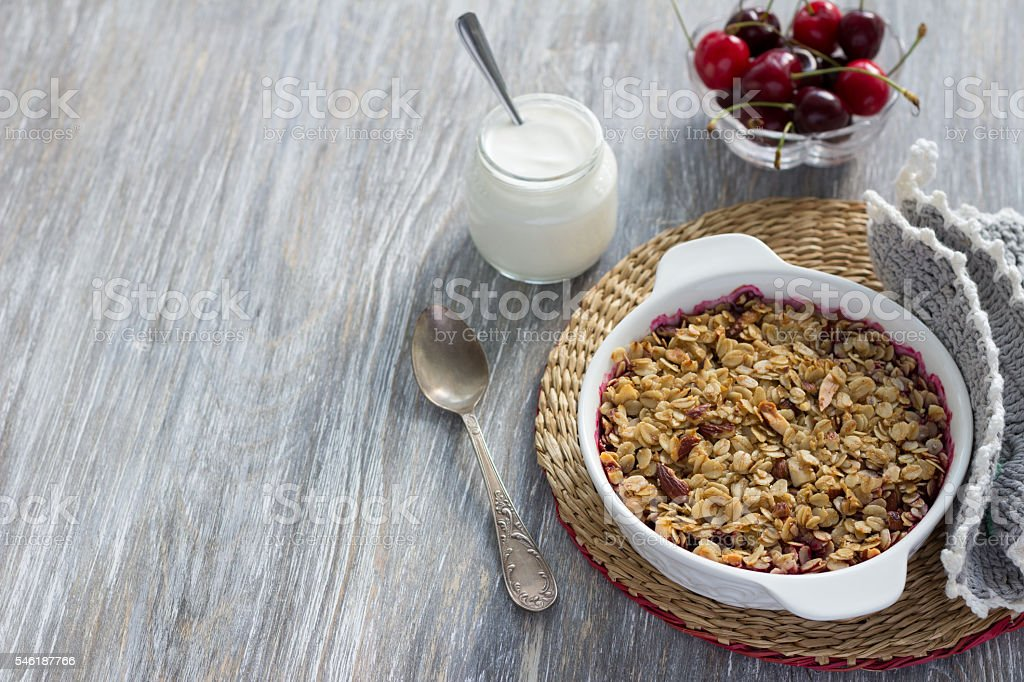 Homemade cherry crumble with oatmeal and almonds stock photo