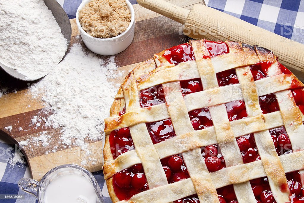 Homemade Cherry Pie on Blue Gingham Checked Tablecloth stock photo