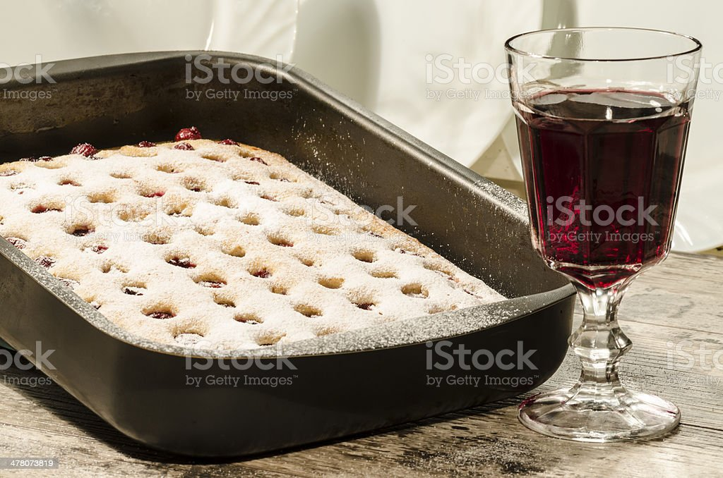 Homemade cherry pie with glass of wine. royalty-free stock photo