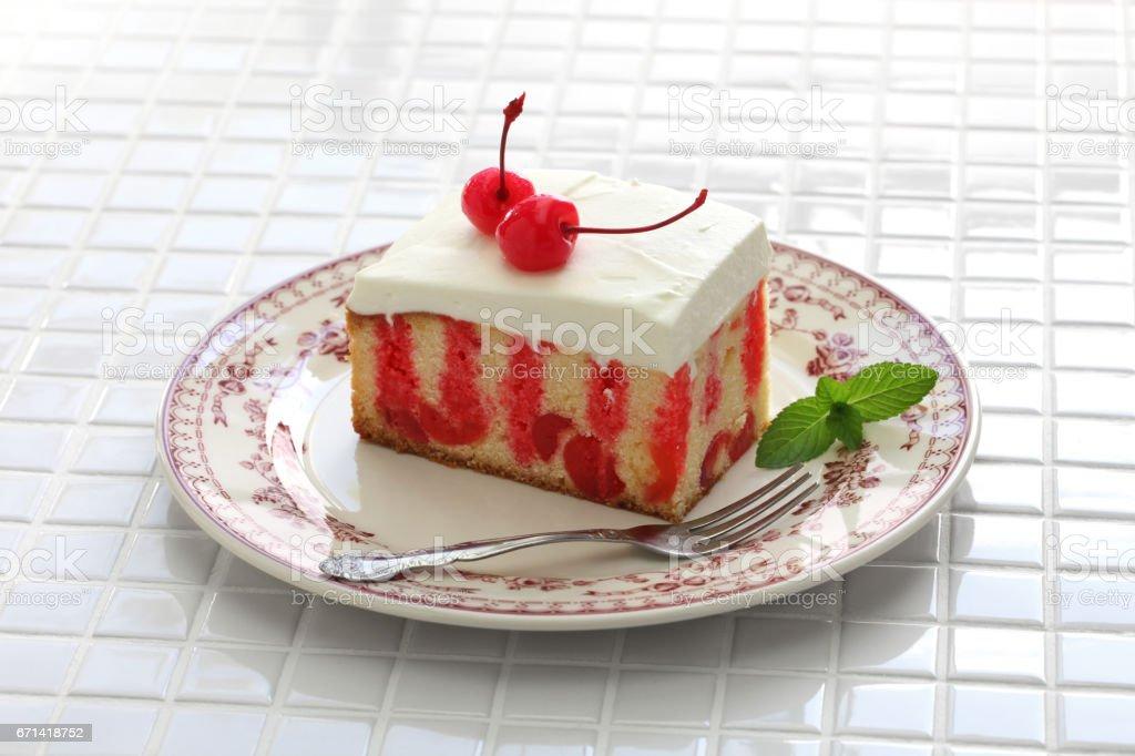 homemade cherry poke cake stock photo