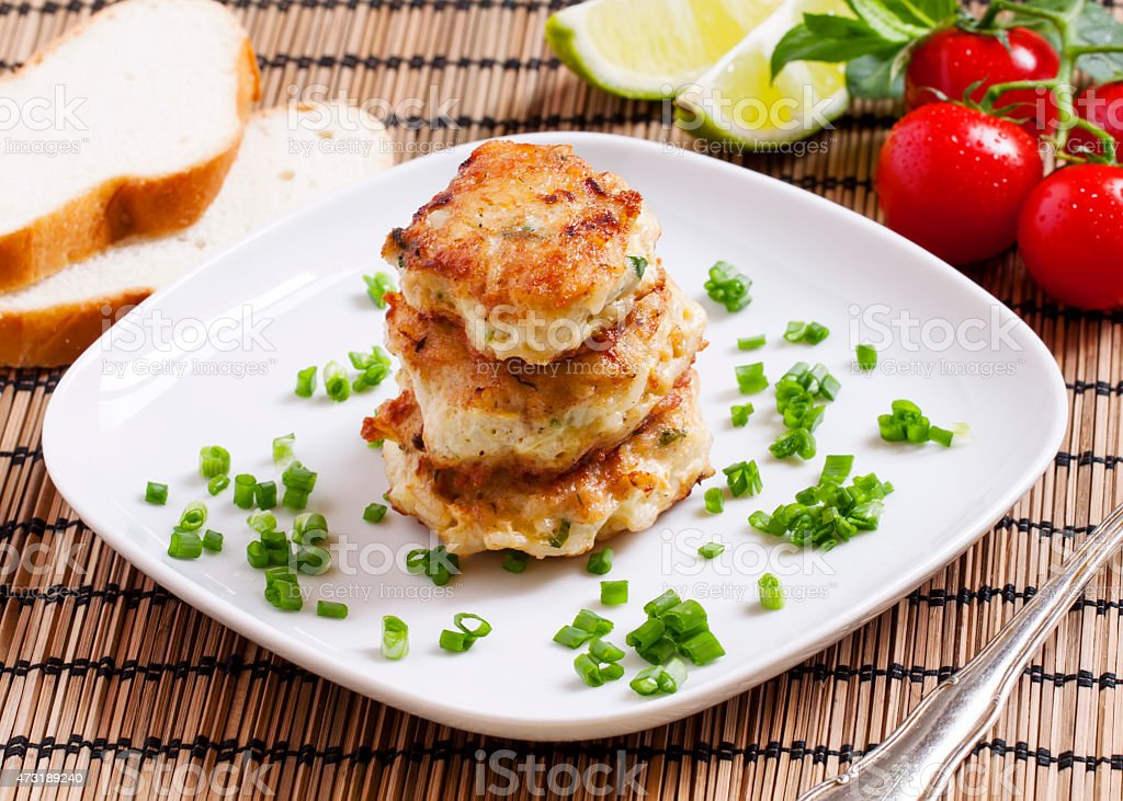 Homemade chicken cutlets sprinkled with green onion, selective f stock photo