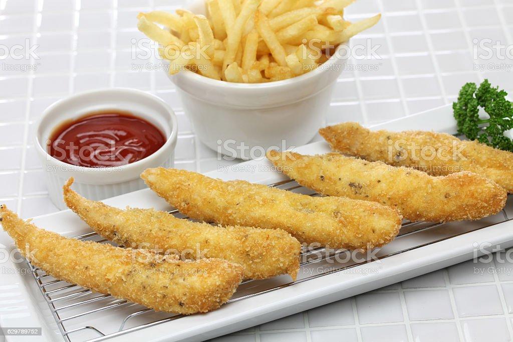 homemade chicken fingers stock photo