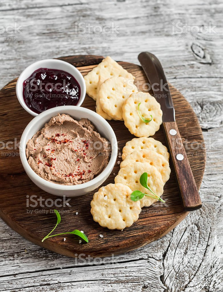 Homemade chicken liver pate, cranberry sauce and homemade cheese biscuits stock photo