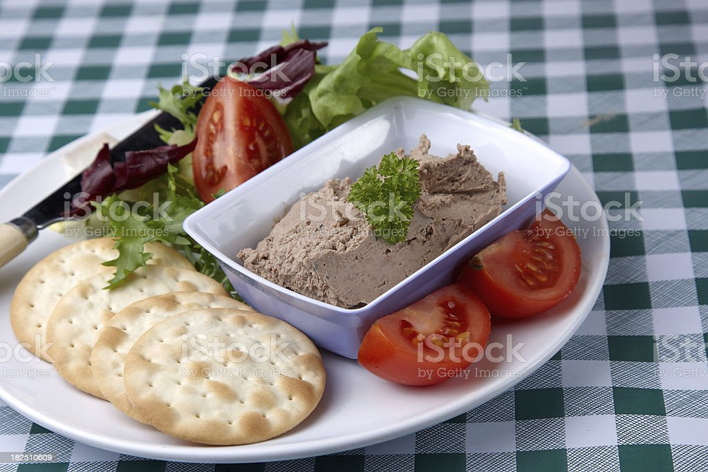 Homemade chicken pate with crackers and salad stock photo