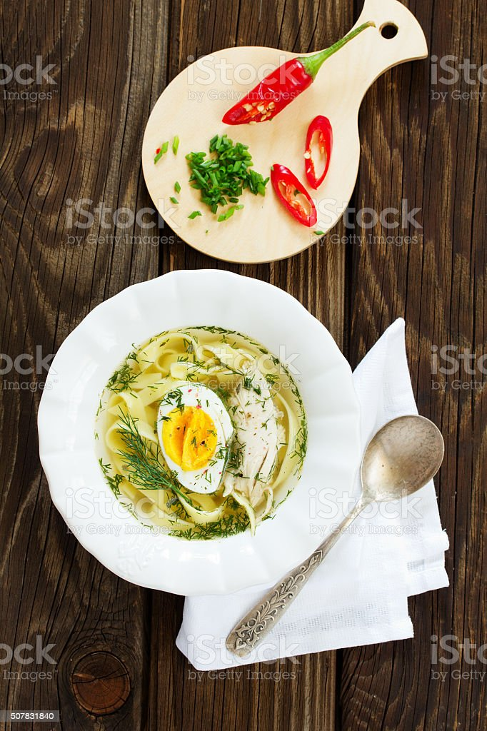 Homemade chicken soup with noodles and egg. stock photo