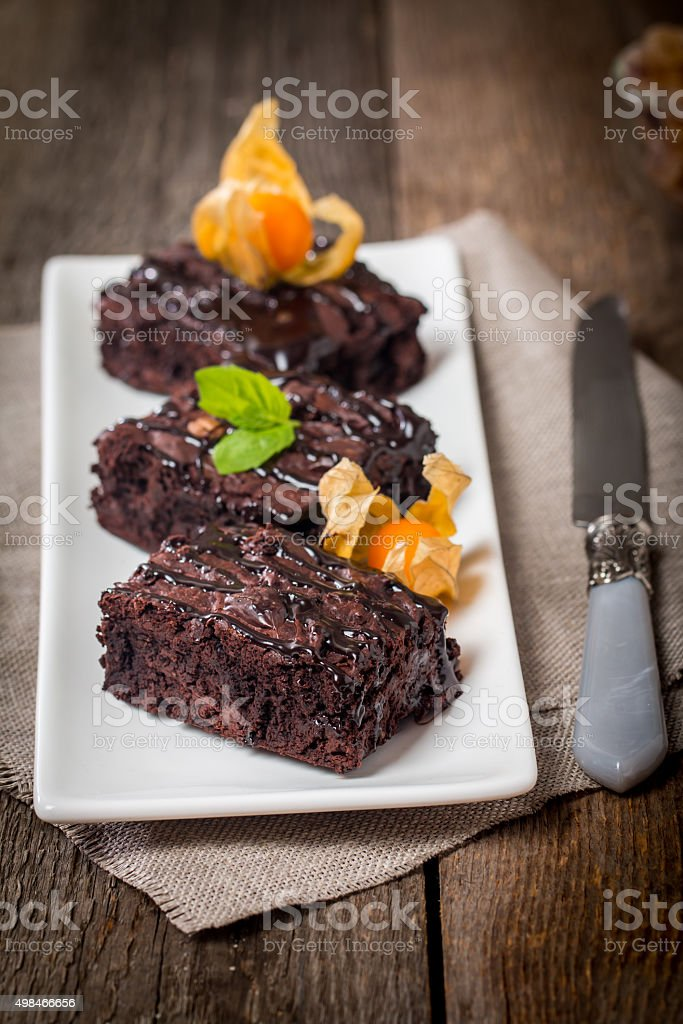 Homemade Chocolate Brownie on a white plate stock photo