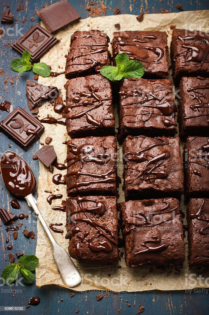 homemade chocolate brownies on dark background stock photo