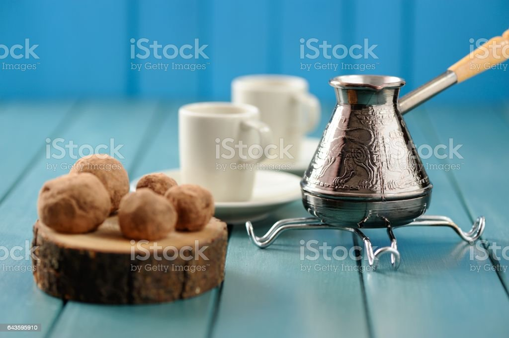 Homemade chocolate candies on wood slabs with cezve stock photo