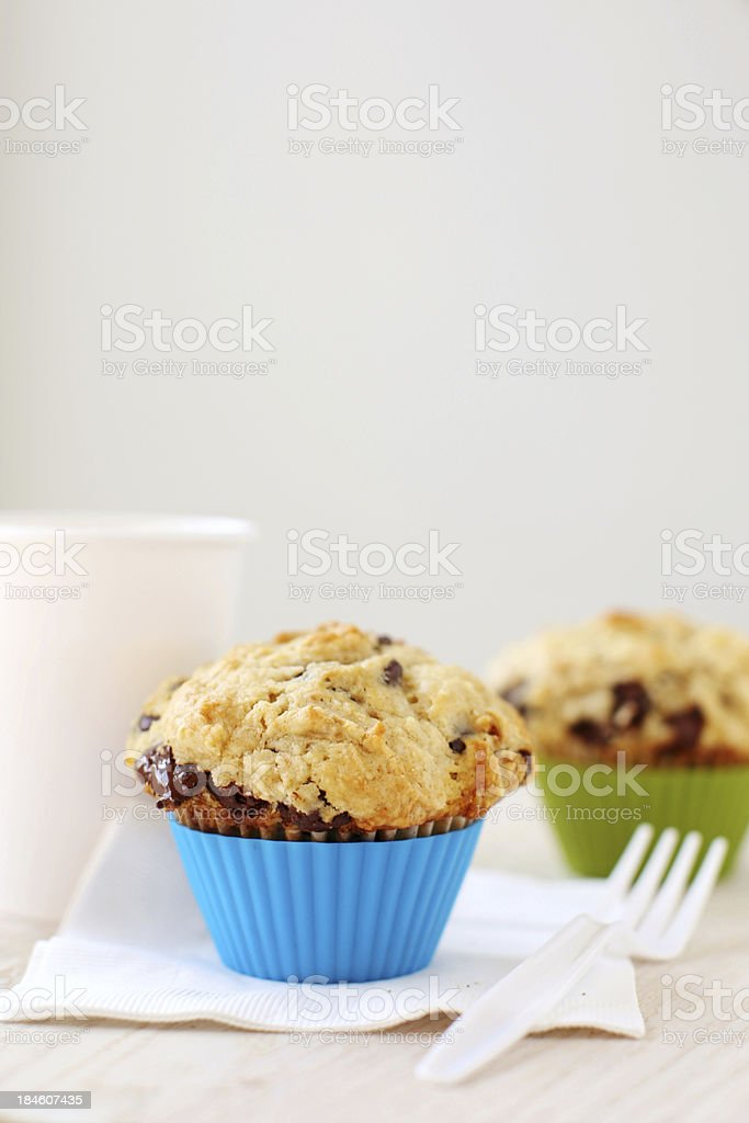 Homemade chocolate chip muffin and orange juice royalty-free stock photo