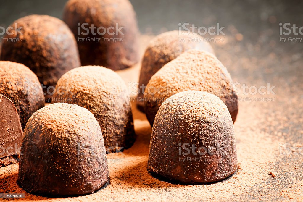 Homemade chocolate truffles with cocoa powder stock photo