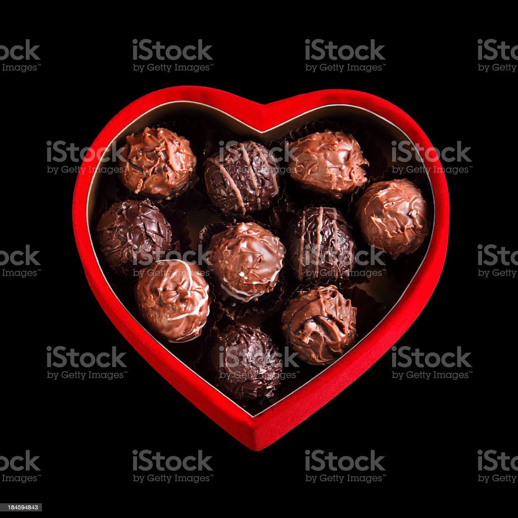 homemade chocolates in heart shaped red box royalty-free stock photo