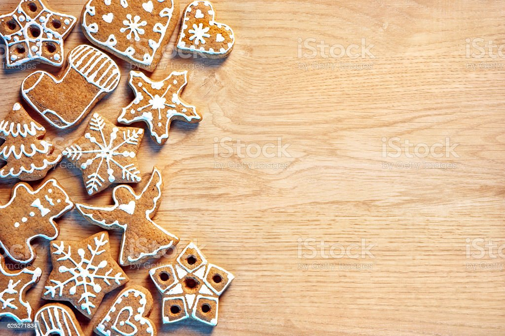 Homemade Christmas cookies on wooden background. stock photo