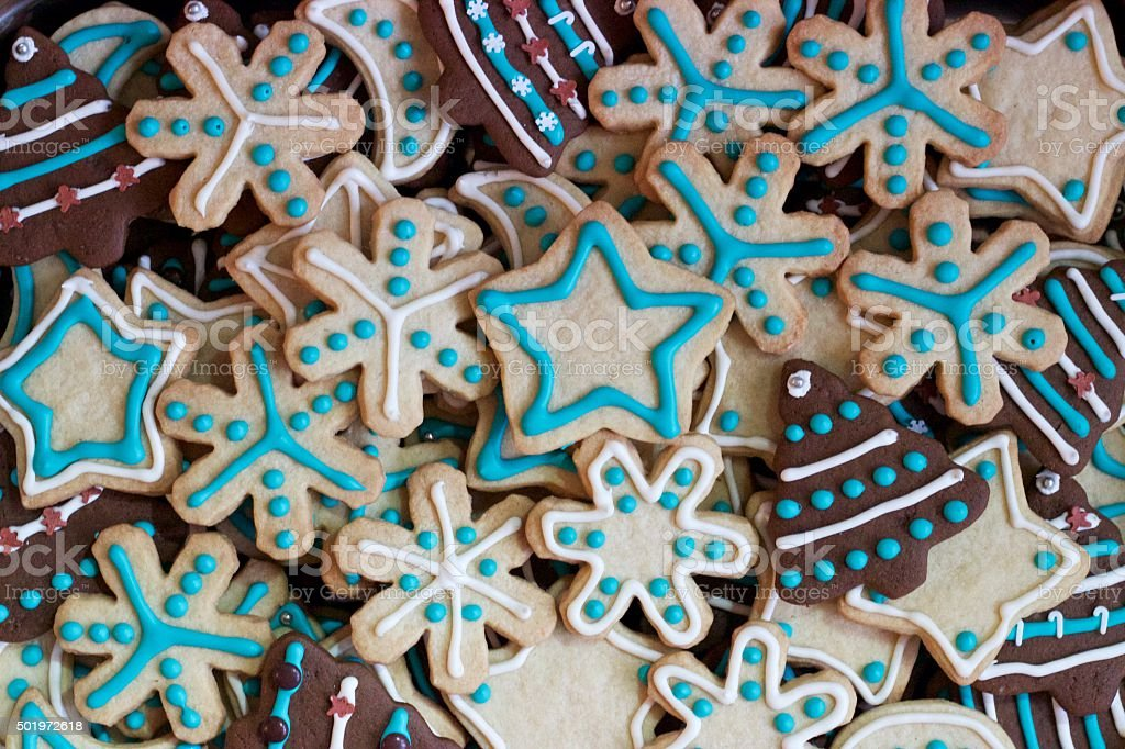Homemade Christmas gingerbread and sugar cookies decorated with royal icing stock photo