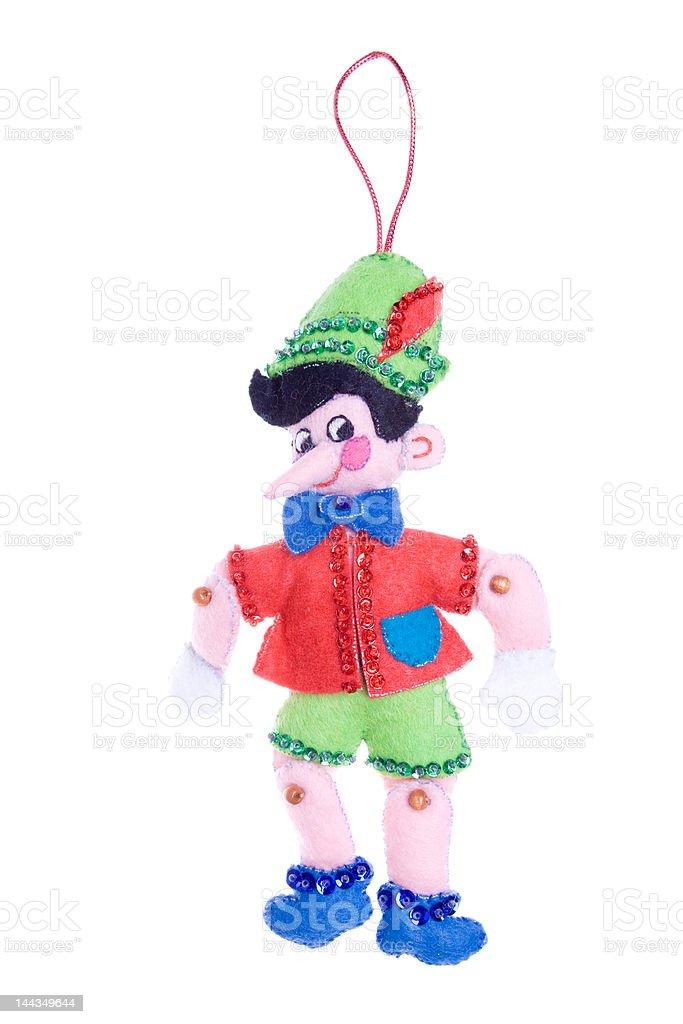 Homemade Christmas Ornament Felt Pinocchio Isolated on White Background stock photo