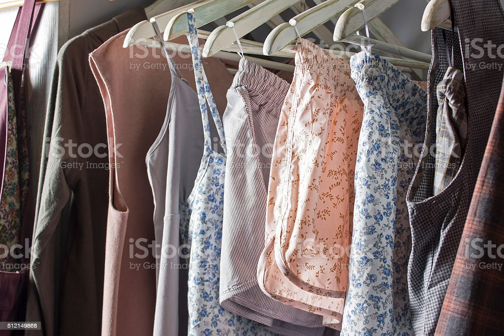 Homemade clothes of different colors hanging in the store stock photo