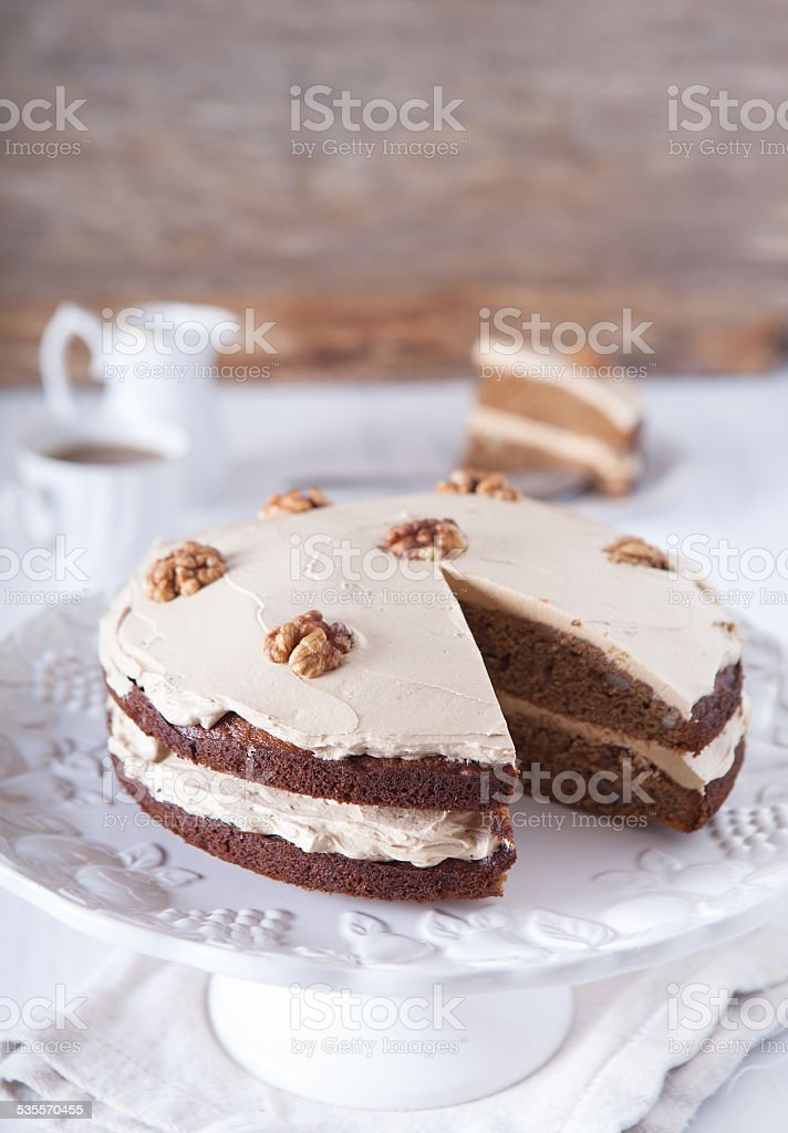 Homemade coffee and walnut cake on the dark wooden table stock photo