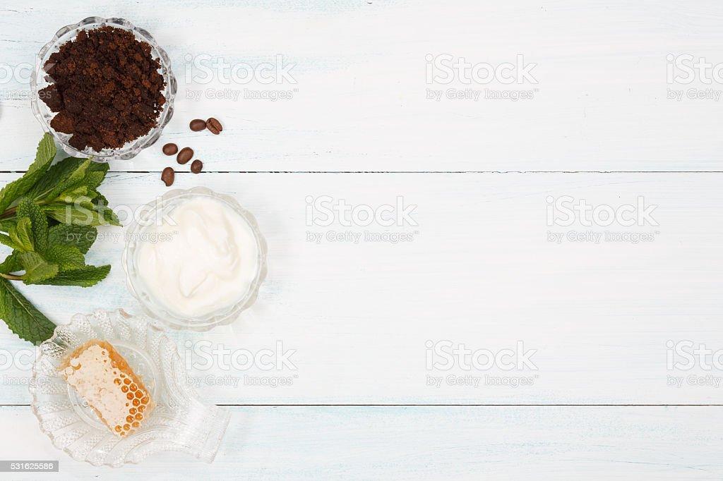 Homemade coffee scrub with, honey , yogurt, mint stock photo