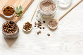 homemade coffee-sugar scrub top view wooden background
