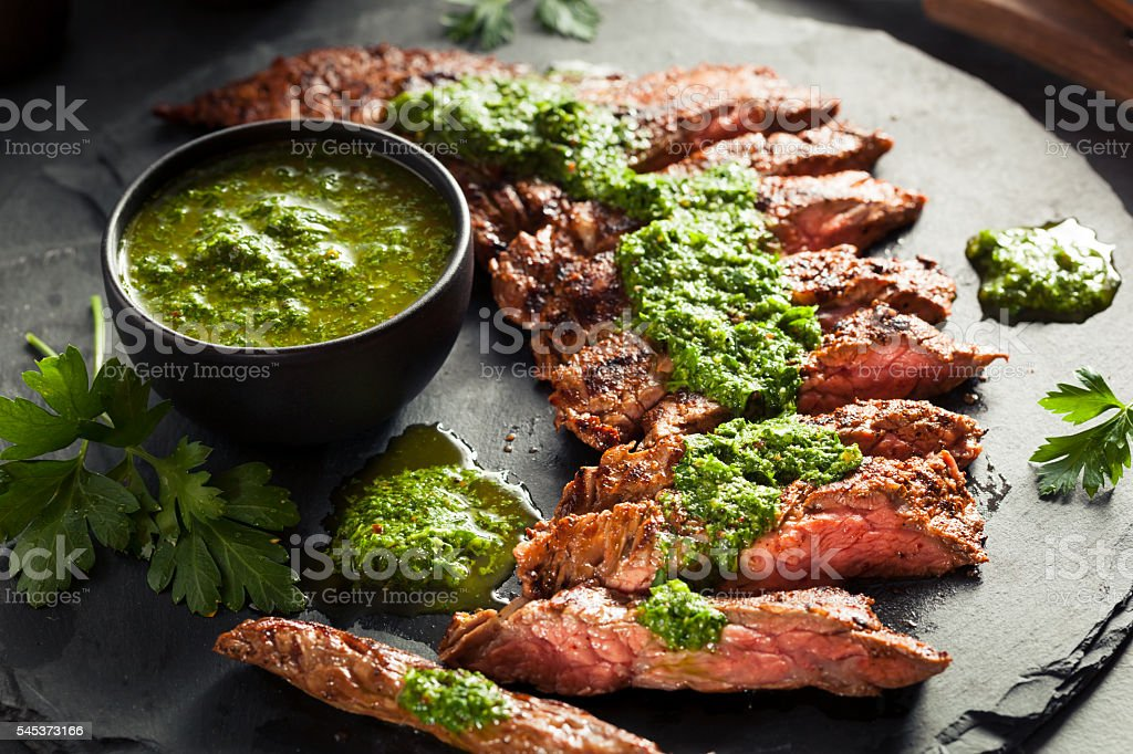 Homemade Cooked Skirt Steak with Chimichurri stock photo