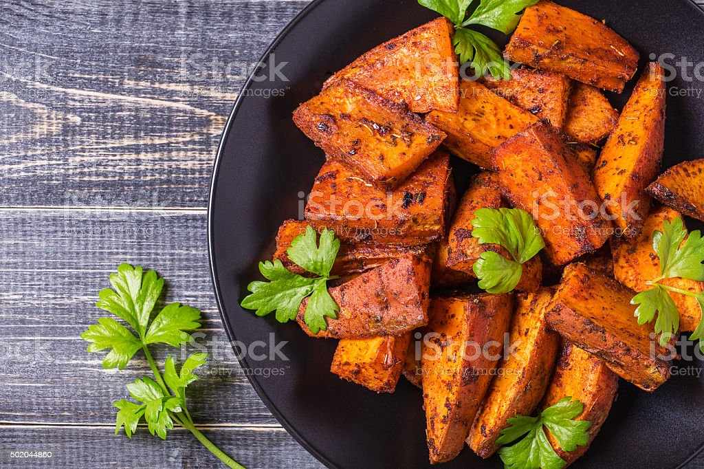 Homemade Cooked Sweet Potato with spices and herbs. stock photo