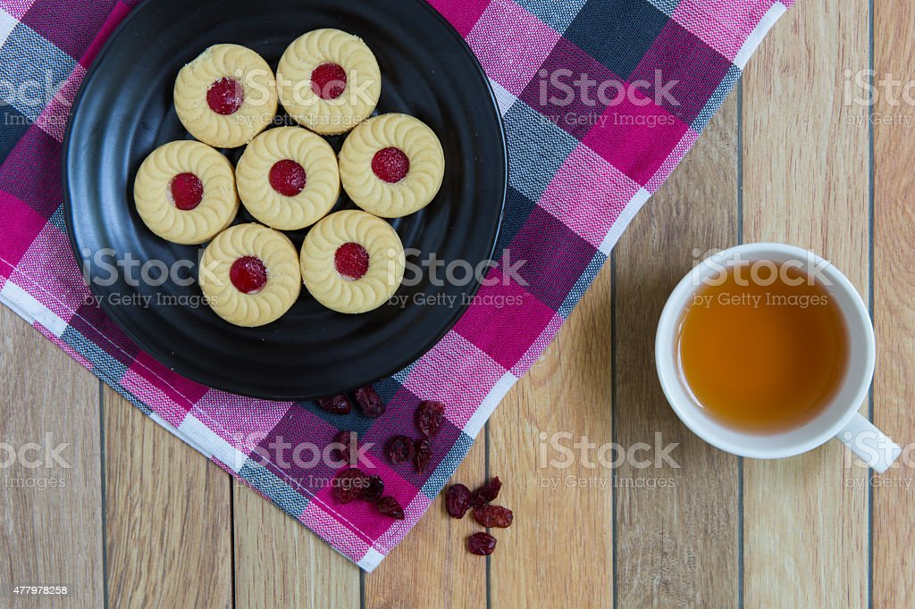 Homemade cookies filled with cranberry jam stock photo